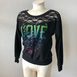 Stranded black lace/rainbow graphics sweatshirt.
